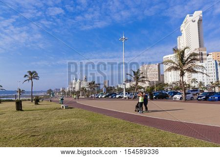 Quiet Promenade On Golden Mile Beachfront Against Cty Skyline
