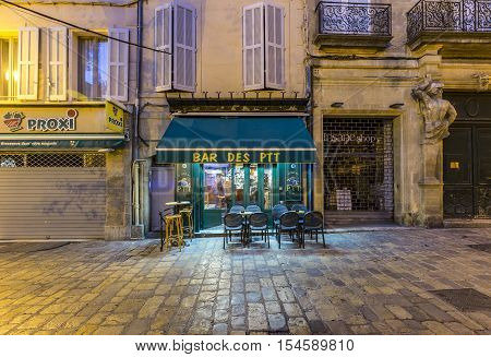 AIX EN PROVENCE FRANCE - OCT 20 2016: old house facade with open french cafe in early morning light in Aix en provence.