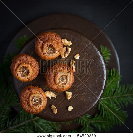 Christmas card. Space for text. Christmas tree on a black wooden background. The original idea of Christmas. New Year. top view blank space for text Christmas. Copy Space. muffins with banana.