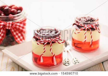 Tasty dessert - berry jelly with vanilla pudding and jellied berries.