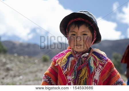Portrait of a Peruvian boy dressed in colourful traditional handmade outfit. October 21 2012 - Patachancha Cuzco Peru