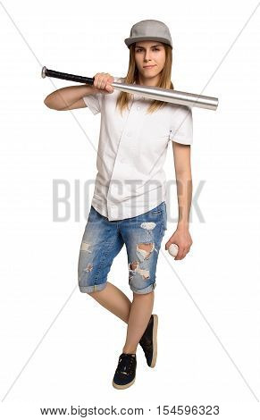 Fashion athletic woman with a baseball bat. The girl in the torn denim shorts and a baseball cap. Copy space. Baseball uniforms. Girl threatened with a baseball bat
