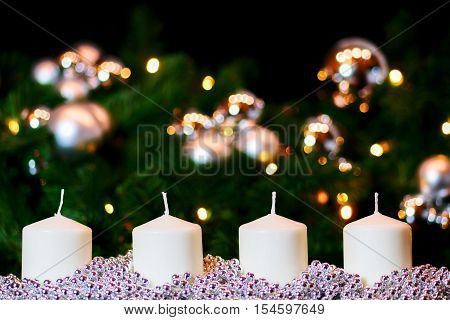 Advent decoration with four red candles and background