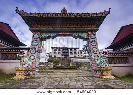The front gate of the monastery Tengboche they guard the mythical animals before sunset.