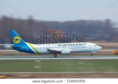 Borispol Ukraine - November 13 2010: Air Ukraine International Boeing 737-400 on its run after the landing