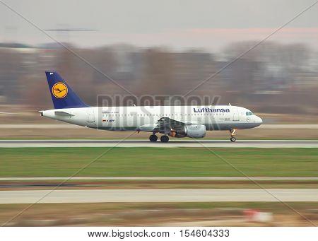 Borispol Ukraine - November 13 2010: Lufthansa Lufthansa Airbus A320 is running after the touchdown - panning image shot