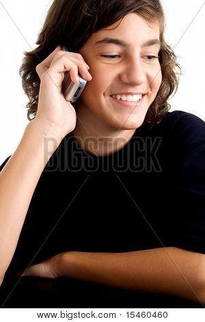 teenage boy portrait leaned on table with cell phone, talking