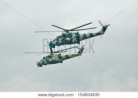 Zhitomir Ukraine - September 29 2010: A pair of Ukrainian Army Mi-24 attack helicopters in flight during military trainings