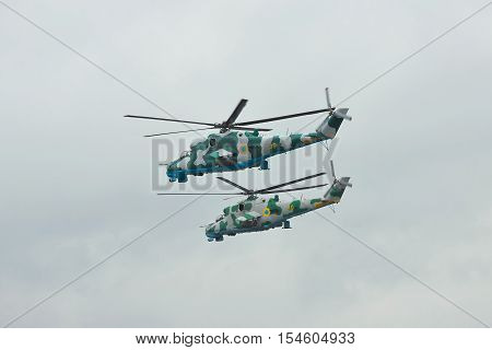 Zhitomir Ukraine - September 29 2010: A pair of Ukrainian Army Mi-24 attack helicopters in flight during military trainings in rainy weather