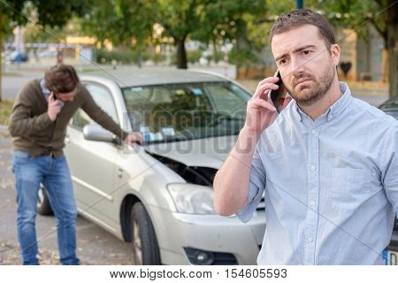 Man Calling Car Mechanic Insurance Assistance After Car Accident