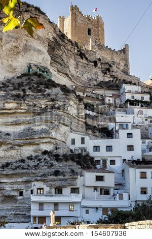 Alcala del Jucar Spain - October 29 2016: Side view of the village on top of limestone mountain is situated Castle of the 12TH century Almohad origin take in Alcala of the Jucar Albacete province Spain