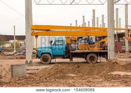 Yellow mobile crane on new construction site