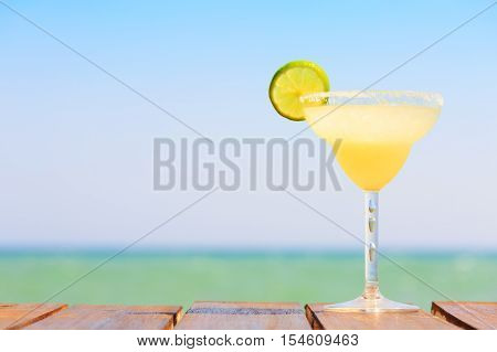 Margarita Cocktail On The Wooden Pier. Concept Of Classic Drink. Vacation Background