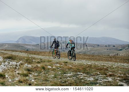 two riders on sport bikes riding on a mountain road. competitions on mountainbike
