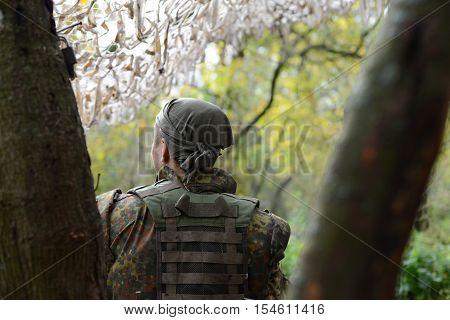 A soldier of the Ukrainian army. Bandana on his head. The bulletproof vest. Wood devevya autumn. Ukraine Lugansk region October 7 2016