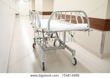 healthcare, reanimation, emergency room and medicine concept - gurney or wheeled stretcher at hospital corridor