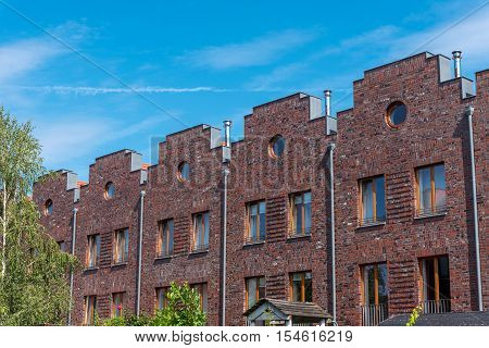 Serial houses with red bricks seen in Berlin, Germany