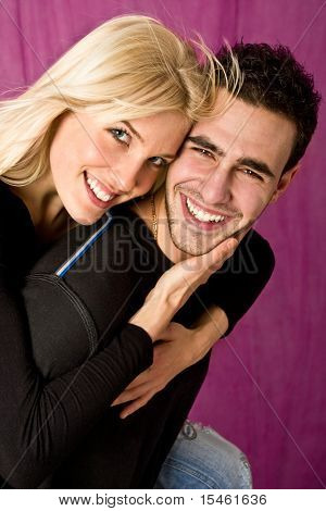 happy young couple, studio shot