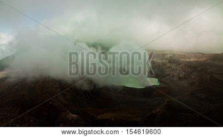 Poas volcano in a heavy dust and fast going clouds, Costa Rica