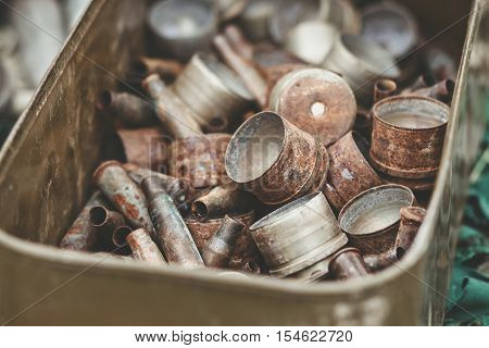 Pile Of Old Rusty Shell Casings From Assault Rifles And Mounted Grenade Launchers In Metal Box