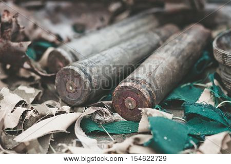 bullet shells from heavy machine gun on the table with camouflage netting
