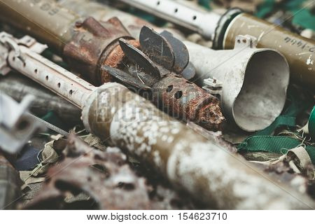 remnants of shells anti-tank rocket propelled grenade launcher and High Mobility Artillery Rocket System