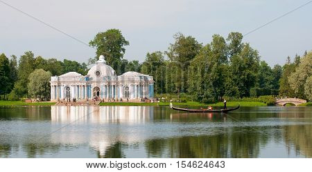 TSARSKOYE SELO, SAINT - PETERSBURG, RUSSIA - JULY 25, 2016: The Grotto Pavilion and the Gondola line on The Great Pond in The Catherine Park. The Tsarskoye Selo is State Museum-Preserve