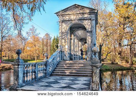 TSARSKOYE SELO, SAINT - PETERSBURG, RUSSIA - OCTOBER 19, 2016: People on The Marble Bridge near the Great Pond in the Catherine Park. The Tsarskoye Selo is State Museum-Preserve.
