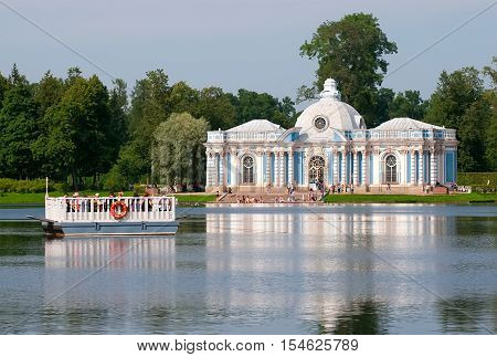 TSARSKOYE SELO, SAINT - PETERSBURG, RUSSIA - JULY 25, 2016: The Grotto Pavilion and the Ferry line on The Great Pond in The Catherine Park. The Tsarskoye Selo is State Museum-Preserve