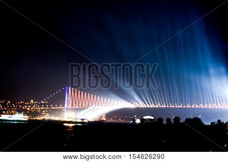 Crowd watch fireworks show over the Istanbul City View of Bosporus Bridge