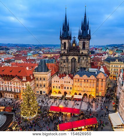 PRAGUE, CZECH REPUBLIC - DECEMBER 10, 2015: Tyn church, Christmas tree and traditional market on Old Town Square of Prague - famous and popular destination with tourists during winter holidays.