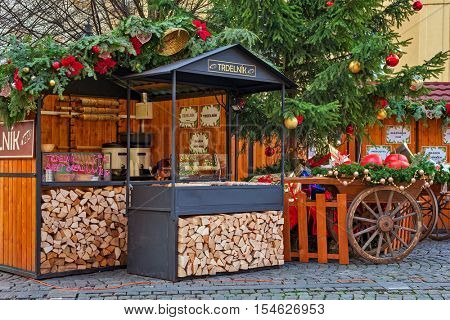 PRAGUE, CZECH REPUBLIC - DECEMBER 10, 2015: Wooden stalls offering traditional sweets and wine during Christmas market taking place each year on December in Old Town of Prague.