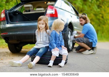 Happy Family Changing A Car Wheel