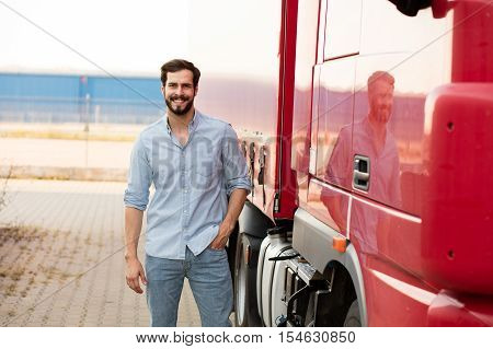 Handsome Truck Driver Standing Outside