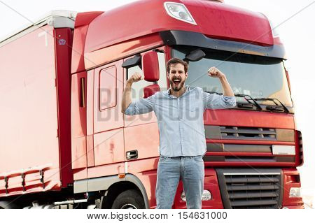 Strong Truck Driver Standing With His Car