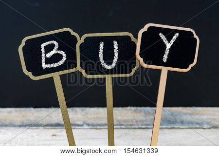 Word Buy Written With Chalk On Wooden Mini Blackboard Labels