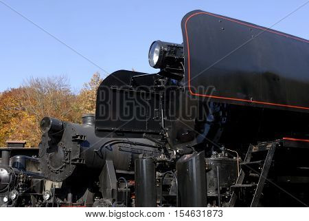 Old Vintage Steam Locomotive At The Train Depot