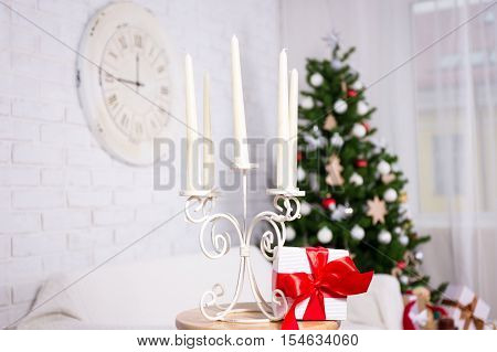 Close Up Of Candles In Vintage Candlestick In Christmas Interior