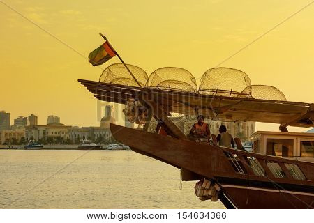 SHARJAH, UAE - OCTOBER 10, 2016:  An old wooden dhow boat loaded with lobster pots ready to go out fishing in the Gulf Waters