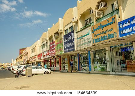 SHARJAH, UAE - OCTOBER 10, 2016: A typical scene of local shops with arabic writing in the old part of Sharjah