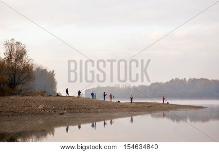 Ruzomberok Slovakia - October 29 2011: Photographers taking photos of beautiful river landscape in the morning. A popular spot for nature photographers