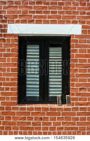 Vintage red brick wall and the window.