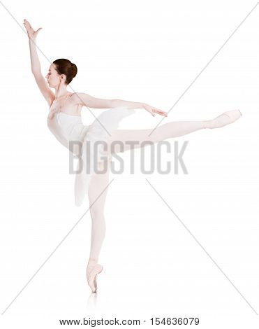 Graceful ballerina makes ballet position arabesque against white background, isolated. Professional dancer in tutu skirt. Choreography classes concept