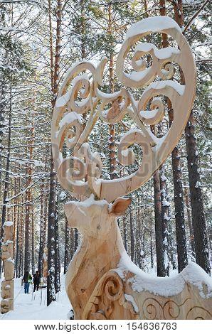 Irkutsk Region,ru-jan, 03 2015: Fairytale Deer. Park Of Wooden Sculptures In Savvateevka