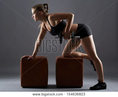 Fitness Girl Doing Dumbbell Rows