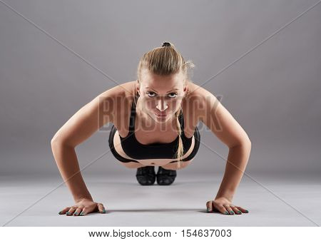Athletic Woman Doing Pushups