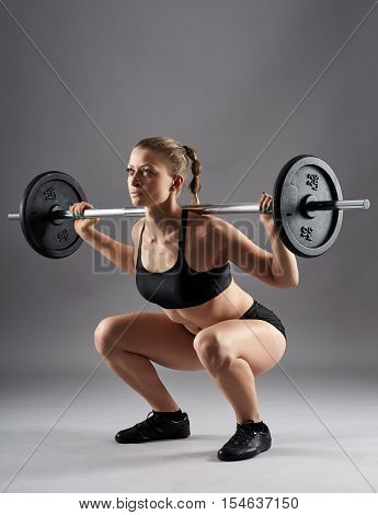 Athletic Woman Doing Barbell Squats
