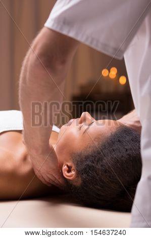Masseur Massaging Beautiful Afroamerican Woman
