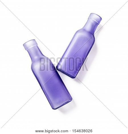 Two lilac glass empty bottles. Handmade vases. Group of objects isolated on white background clipping path included. Top view flat lay