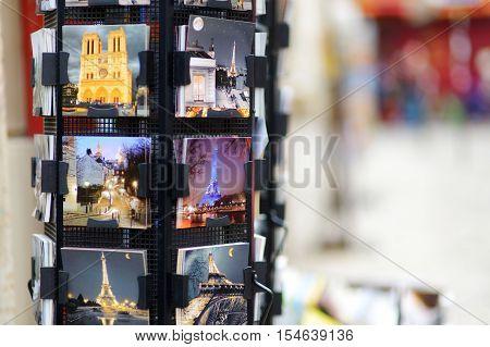 MARCH 1 2015 - PARIS: Various postcards from Paris displayed at souvenir shop